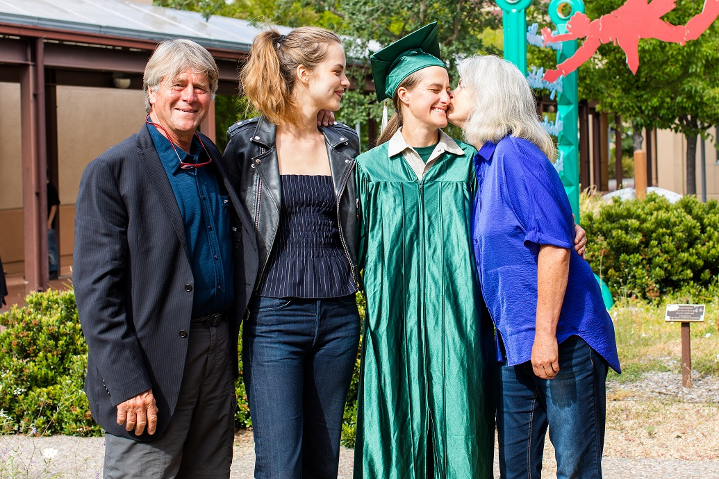 Erin M and her family posing at the 2019 graduation.